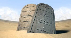 30736269-two-stone-tablets-with-the-ten-commandments-inscribed-on-them-standing-in-brown-desert-sand-infront-